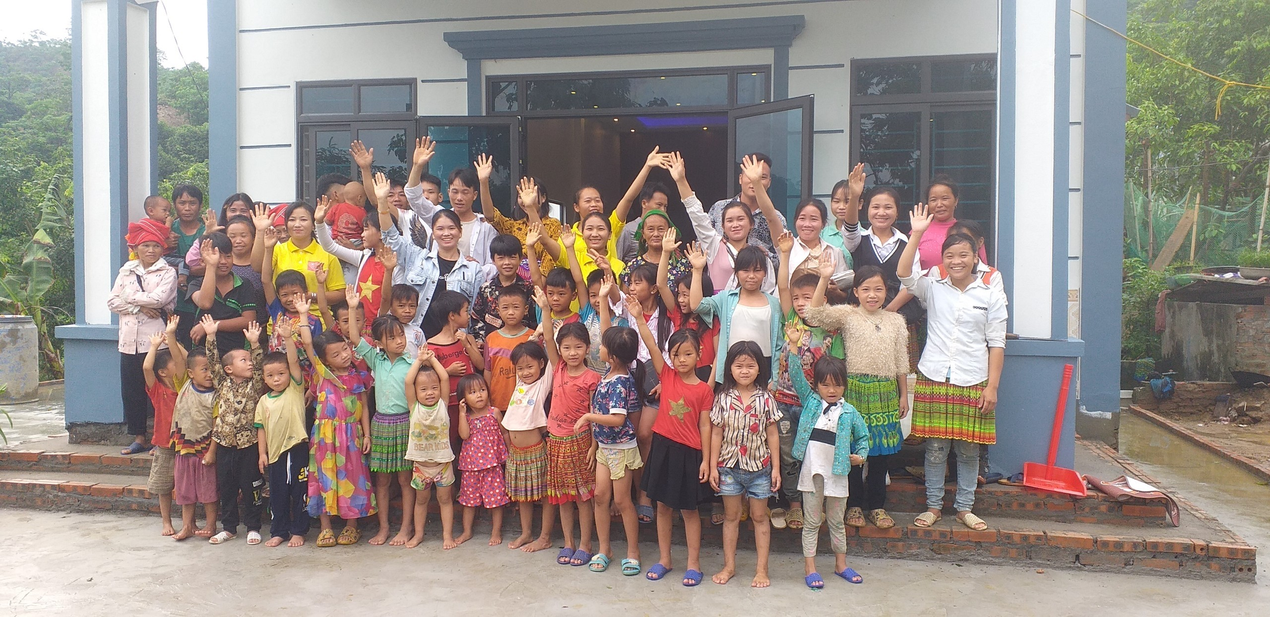 Members at Son Thuy church wave greetings and thanks for help with their beautiful new building.